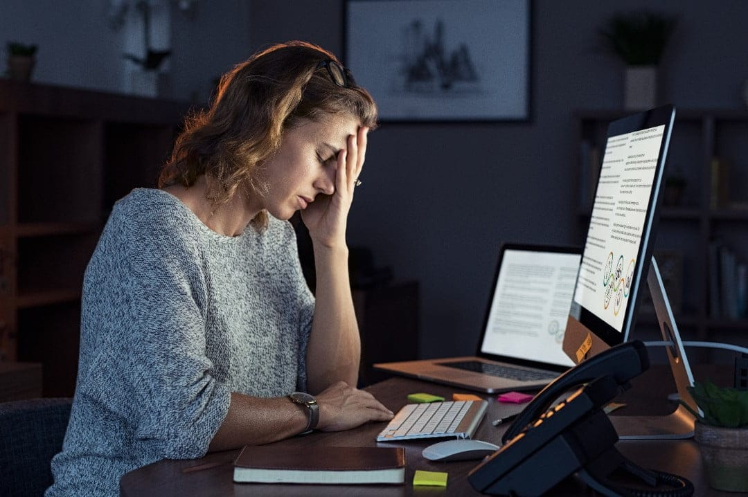 woman-at-computer-with-burnout